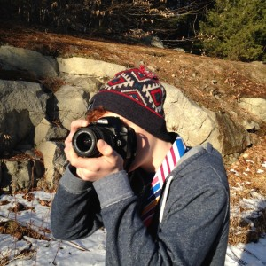 teenage boy aiming camera