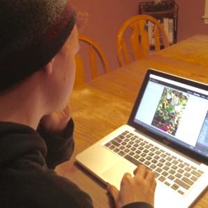 teenage boy working on computer